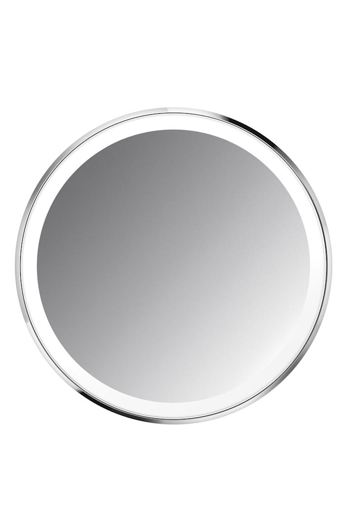"""<p><strong>SIMPLEHUMAN</strong></p><p>nordstrom.com</p><p><strong>$80.00</strong></p><p><a href=""""https://go.redirectingat.com?id=74968X1596630&url=https%3A%2F%2Fwww.nordstrom.com%2Fs%2Fsimplehuman-4-inch-sensor-makeup-mirror-compact%2F5792107&sref=https%3A%2F%2Fwww.townandcountrymag.com%2Fstyle%2Fbeauty-products%2Fg36256297%2Fbest-compact-mirrors%2F"""" rel=""""nofollow noopener"""" target=""""_blank"""" data-ylk=""""slk:Shop Now"""" class=""""link rapid-noclick-resp"""">Shop Now</a></p><p>If there's one thing we've learned from the Zoom era, it's that light matters. This smart LED mirror simulates natural sunlight, and provides 3x magnification so you can be ready for any close-up. </p>"""