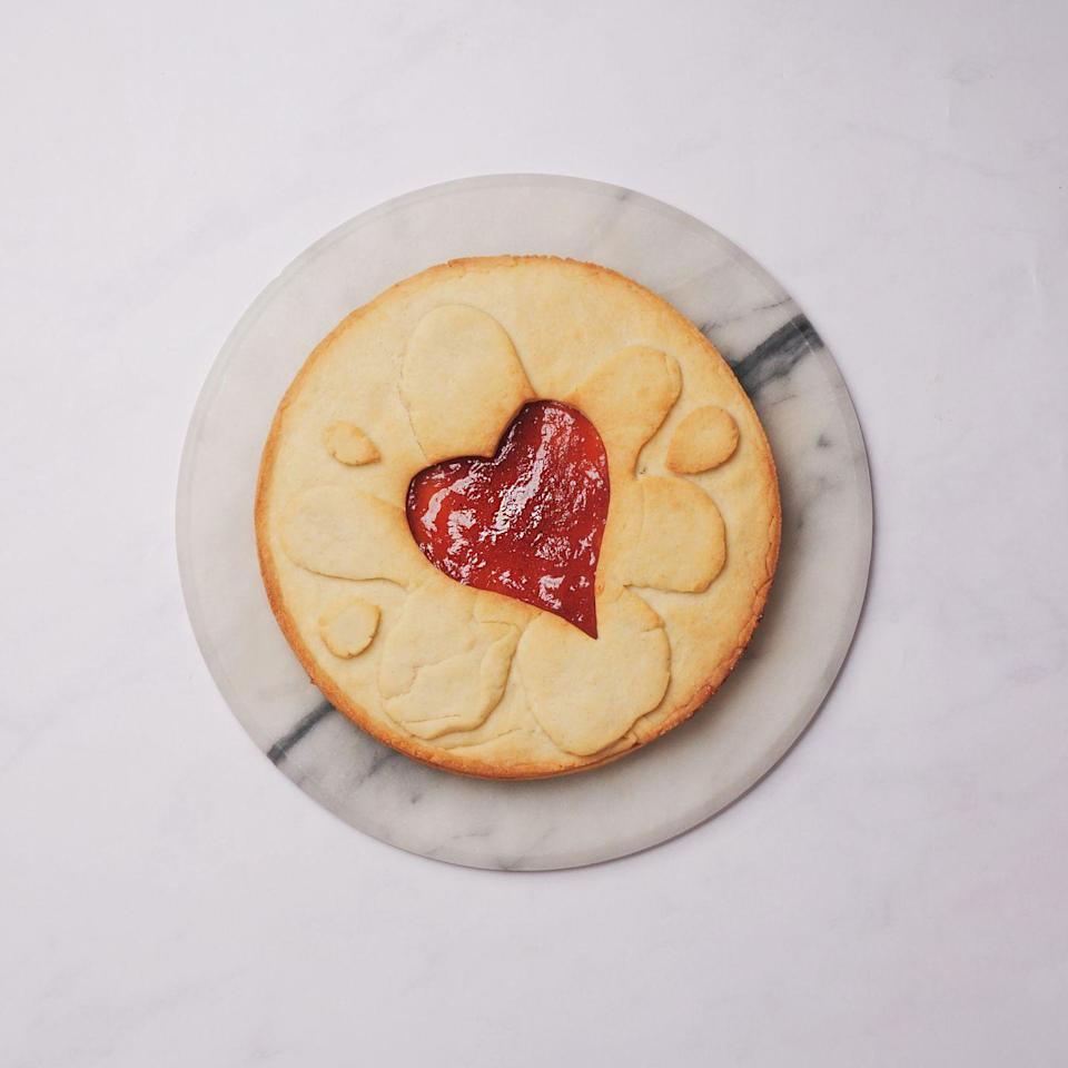 """<p>Delicious gooey jam, sandwiched between two giant shortbread <a href=""""https://www.goodhousekeeping.com/uk/food/recipes/g538635/15-of-the-best-biscuit-and-cookie-recipes/"""" rel=""""nofollow noopener"""" target=""""_blank"""" data-ylk=""""slk:biscuits"""" class=""""link rapid-noclick-resp"""">biscuits</a> and shaped to look like the British classic, the <a href=""""https://www.google.com/url?client=internal-element-cse&cx=017432150296003816733:f5wfv43ykjk&q=https://www.goodhousekeeping.com/uk/food/recipes/a536862/jammy-delights-biscuits/&sa=U&ved=2ahUKEwjuqfi-4fPlAhUxAGMBHREyDp8QFjABegQICBAC&usg=AOvVaw0kJ325WGBY_DET1BKWZDWM"""" rel=""""nofollow noopener"""" target=""""_blank"""" data-ylk=""""slk:Jammy Dodger"""" class=""""link rapid-noclick-resp"""">Jammy Dodger</a>! It doesn't get much better than that and we know you'll love this giant biscuit recipe. Don't forget to allow chilling and cooling time!</p><p><strong>Recipe: <a href=""""https://www.goodhousekeeping.com/uk/food/recipes/a29828503/giant-jammy-dodger/"""" rel=""""nofollow noopener"""" target=""""_blank"""" data-ylk=""""slk:Giant jammy dodger"""" class=""""link rapid-noclick-resp"""">Giant jammy dodger</a></strong></p>"""