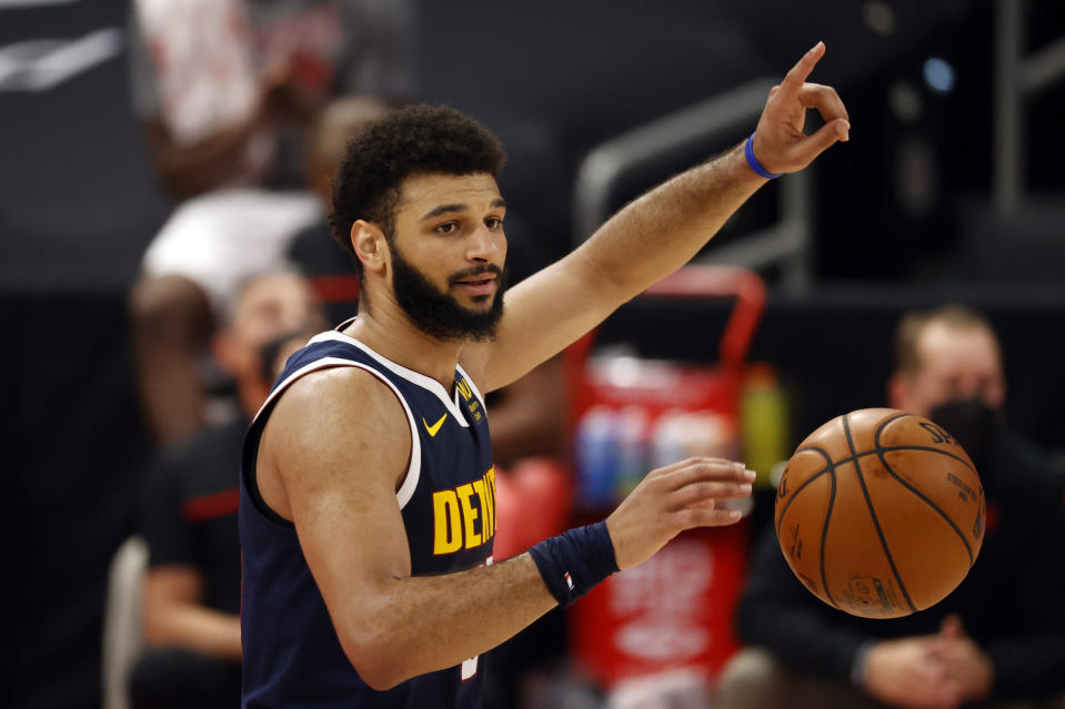Mar 24, 2021; Tampa, Florida, USA; Denver Nuggets guard Jamal Murray (27) dribbles the ball against the Toronto Raptors during the first half at Amalie Arena.