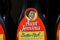 Bottles of Aunt Jemima branded syrup stand on a store shelf inside of a shop in the Brooklyn borough of New York City