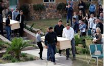 Men carry the remains of Dawna Ray Langford, 43, and her sons Trevor and Rogan, who were killed by unknown assailants, before they are buried at the cemetery in La Mora
