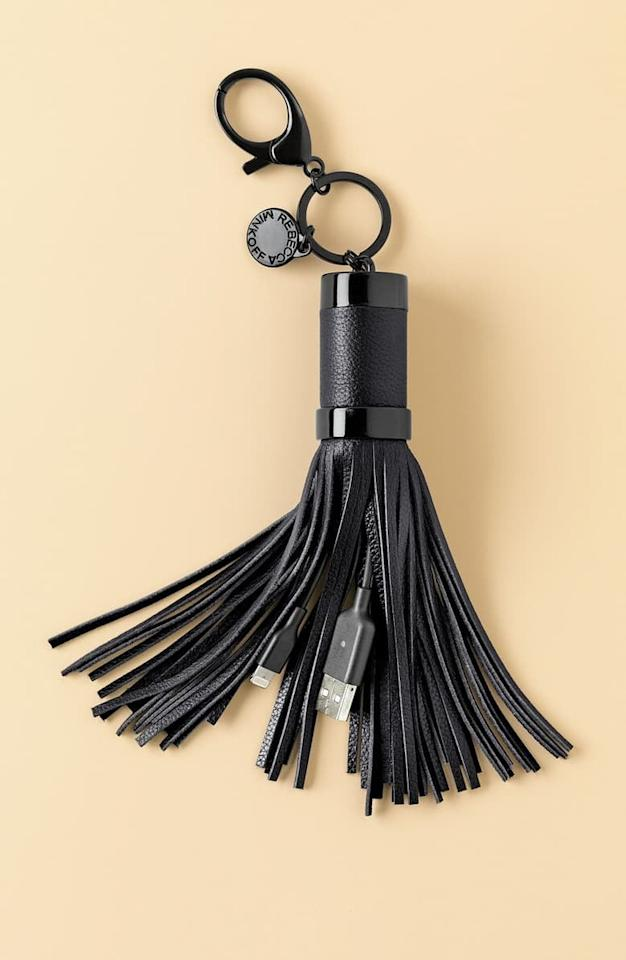 "<p>They'll never lose charge again with this <a href=""https://www.popsugar.com/buy/Rebecca-Minkoff-Power-Tassel-Bag-Charm-499119?p_name=Rebecca%20Minkoff%20Power%20Tassel%20Bag%20Charm&retailer=shop.nordstrom.com&pid=499119&price=50&evar1=geek%3Aus&evar9=26294675&evar98=https%3A%2F%2Fwww.popsugar.com%2Fphoto-gallery%2F26294675%2Fimage%2F46728989%2FRebecca-Minkoff-Power-Tassel-Bag-Charm&list1=shopping%2Cgadgets%2Choliday%2Cgift%20guide%2Choliday%20living%2Ctech%20gifts%2Cgifts%20under%20%24100&prop13=api&pdata=1"" rel=""nofollow"" data-shoppable-link=""1"" target=""_blank"" class=""ga-track"" data-ga-category=""Related"" data-ga-label=""https://shop.nordstrom.com/s/rebecca-minkoff-power-tassel-bag-charm/4520394?origin=category-personalizedsort&amp;breadcrumb=Home%2FHome%20%26%20Gifts%2FHome%2FElectronics%20%26%20Tech%20Accessories&amp;color=neon%20pink"" data-ga-action=""In-Line Links"">Rebecca Minkoff Power Tassel Bag Charm</a> ($50).</p>"