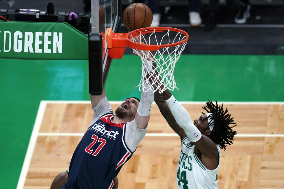 Washington Wizards center Alex Len (27) and Boston Celtics center Robert Williams III (44) vie for a rebound during the first half of an NBA basketball Eastern Conference play-in game Tuesday, May 18, 2021, in Boston. (AP Photo/Charles Krupa)