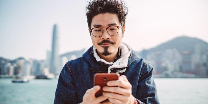 person looking at phone outside