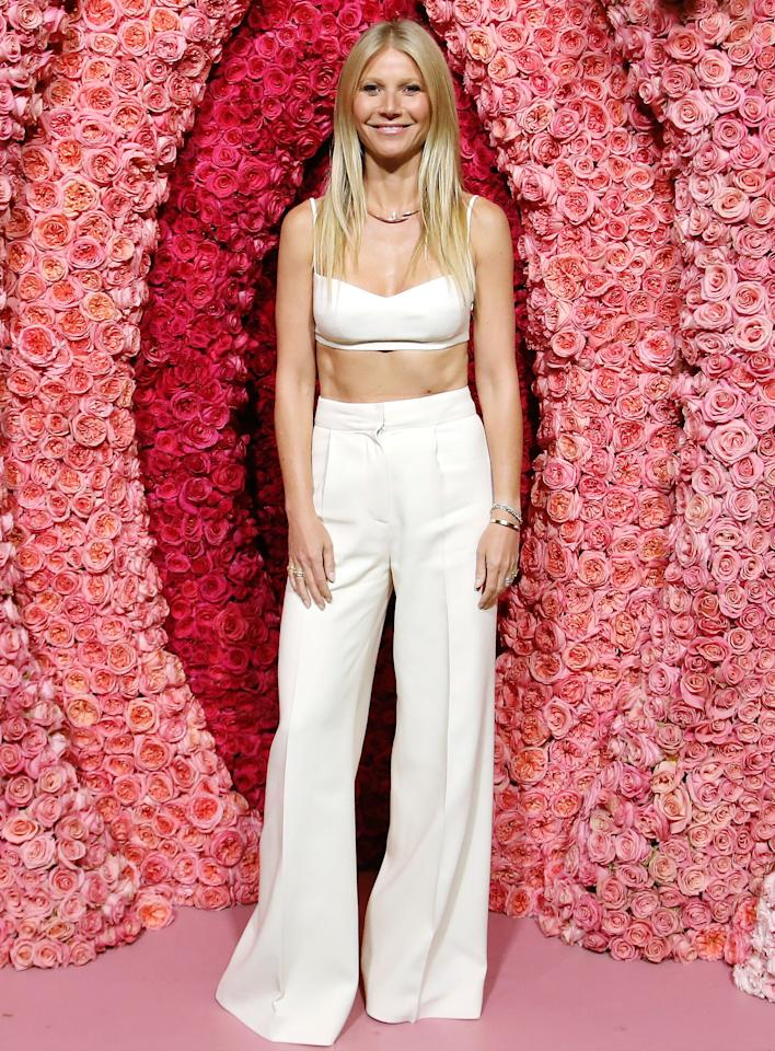 in a white bralette and matchingtrousers, paired with a rose gold collar necklace at the <em>goop lab</em> special screening in L.A.