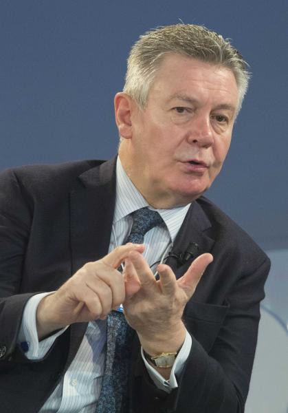 EU Trade Commissioner Karel De Gucht, gestures as he speaks with U.S. Trade Representative Michael Froman prior to a session at the World Economic Forum in Davos, Switzerland, Saturday, Jan. 25, 2014. Global leaders argued Friday that efforts to eradicate poverty must be linked to climate change, saying that rising temperatures will have widespread effects on everything from food supplies to education. (AP Photo/Michel Euler)