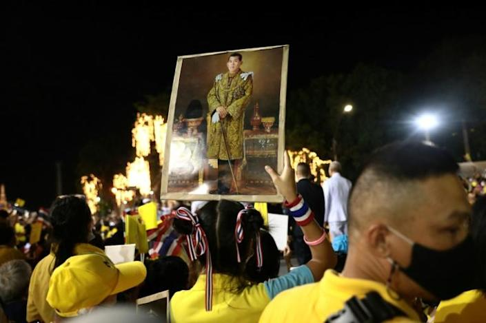 A royalist supporter holds a portrait of Thailand's King Maha Vajiralongkorn