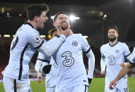 Chelsea's Jorginho, centre, celebrates after scoring the 2-1 lead from the penalty spot during the English Premier League soccer match between Sheffield United and Chelsea at Bramall Lane stadium in Sheffield, England, Sunday, Feb. 7, 2021. (Oli Scarff/ Pool via AP)