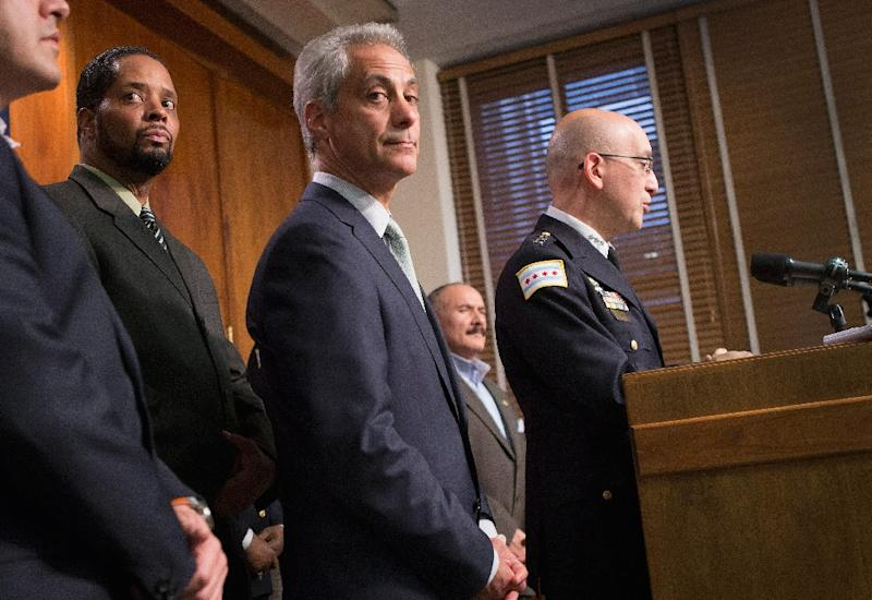 Chicago Mayor Rahm Emanuel (C) listens as Interim Chicago Police Superintendent John Escalante addresses changes in training and procedures for police in the wake of recent shootings (AFP Photo/Scott Olson)