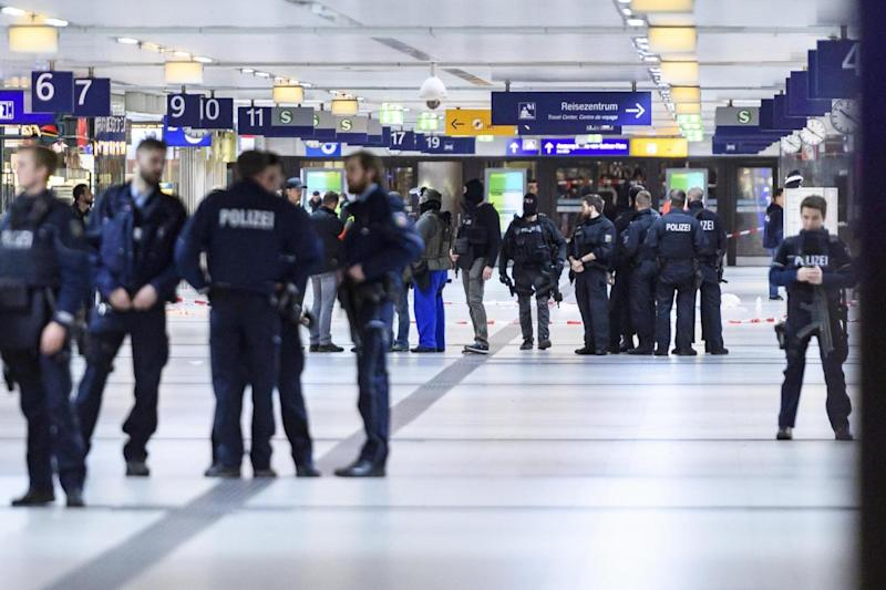 Police and emergency workers stand outside the main railway station. (Getty Images)
