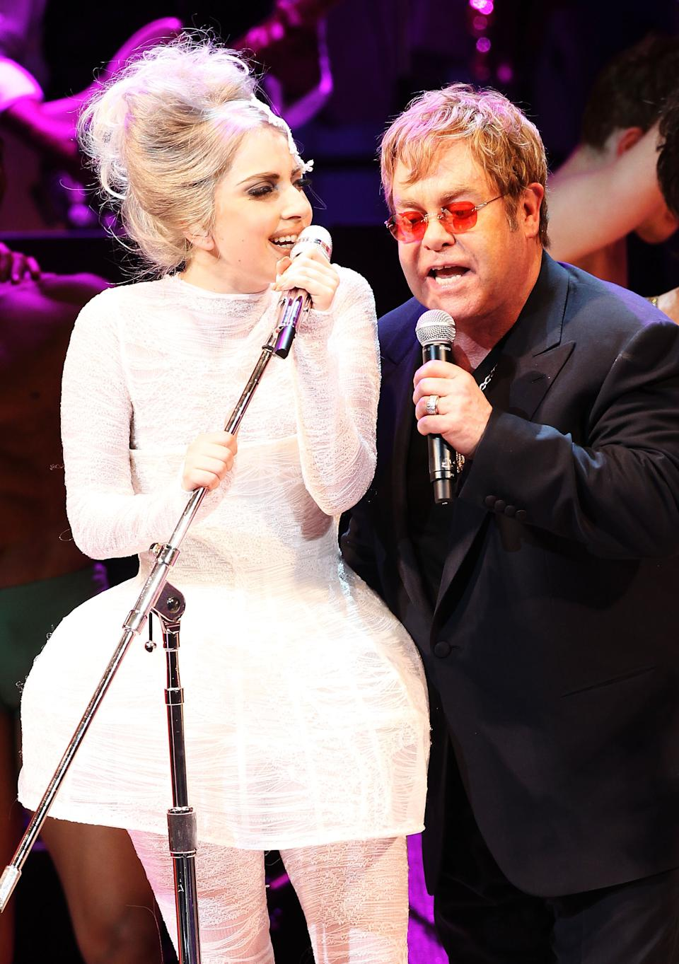 NEW YORK - MAY 13:  Lady Gaga and Elton John perform on stage during the Almay concert to celebrate the Rainforest Fund's 21st birthday at Carnegie Hall on May 13, 2010 in New York City.  (Photo by Kevin Kane/WireImage)