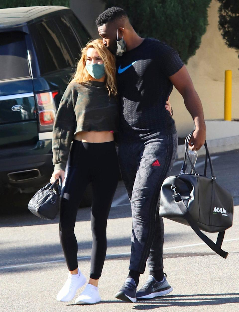 <p>Chrishell Stause and new love Keo Motsepe keep close on Wednesday following a workout in L.A. </p>
