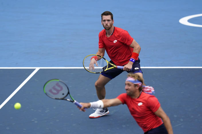 The United States doubles team of Tennys Sandgren, bottom, and Austin Krajicek play during the men's doubles bronze medal match of the tennis competition at the 2020 Summer Olympics, Friday, July 30, 2021, in Tokyo, Japan. (AP Photo/Seth Wenig)