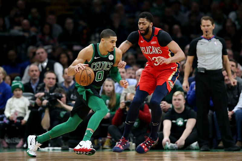 BOSTON, MA - DECEMBER 10: Jayson Tatum #0 of the Boston Celtics drives against Anthony Davis #23 of the New Orleans Pelicans at TD Garden on December 10, 2018 in Boston, Massachusetts. (Photo by Maddie Meyer/Getty Images)