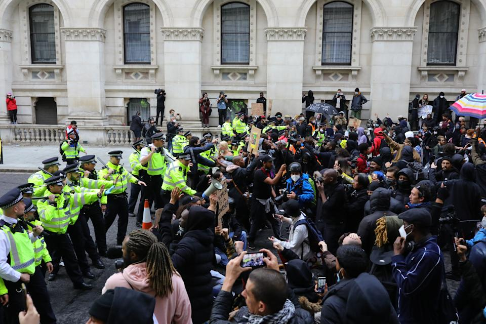 Police clash with protesters during a Black Lives Matter protest rally in Westminster, London, in memory of George Floyd who was killed on May 25. (PA)