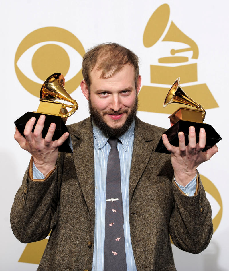 "Justin Vernon poses backstage with the award for best alternative music album for ""Bon Iver"" at the 54th annual Grammy Awards on Sunday, Feb. 12, 2012 in Los Angeles. (AP Photo/Mark J. Terrill)"