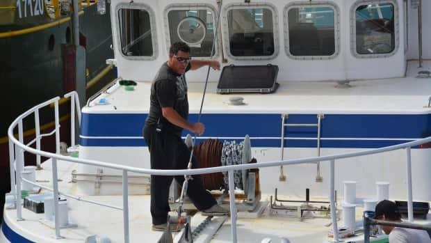 Rodney Barnaby, a Mi'kmaw fisher, gets his boat ready to head out on the water.