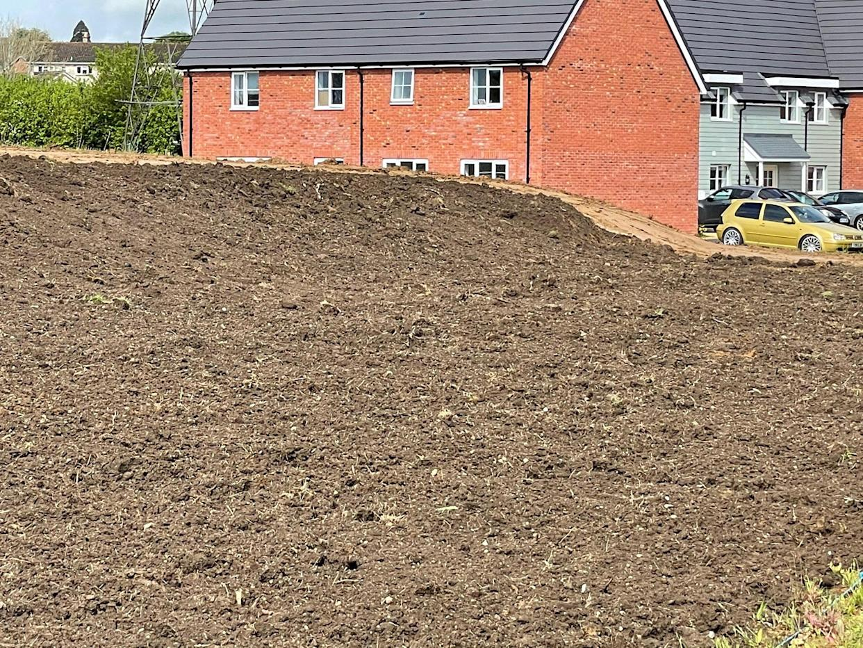 Contractors left the 2.5m mound of topsoil next to new-build Park Place. (SWNS)