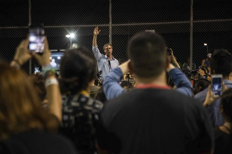 Democratic presidential candidate Beto O'Rourke addresses people during a vigil  Sunday, Aug. 4, 2019, at Ponder Park in honor to the victims of a mass shooting occurred in Walmart on Saturday, Aug. 3, 2019, in El Paso, Texas.  (Lola Gomez/Austin American-Statesman via AP)