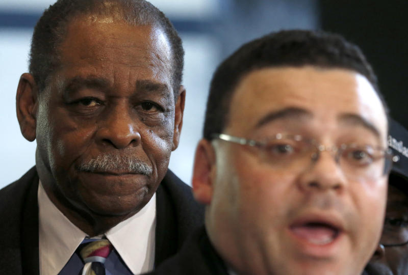 Cook County Commissioner William Beavers, left, listens to his attorney Sam Adam Jr., as they meet with reporters at the federal building in Chicago, Thursday, March 21, 2013, after Beavers was convicted of tax evasion for not declaring campaign cash he gambled away on slot machines as income. Beavers, whose commissioner's salary is $85,000, lost $500,000 over three years at Indiana's Horseshoe Casino, sometimes writing himself one $2,000 campaign check after another on daylong gambling binges. (AP Photo/Charles Rex Arbogast)
