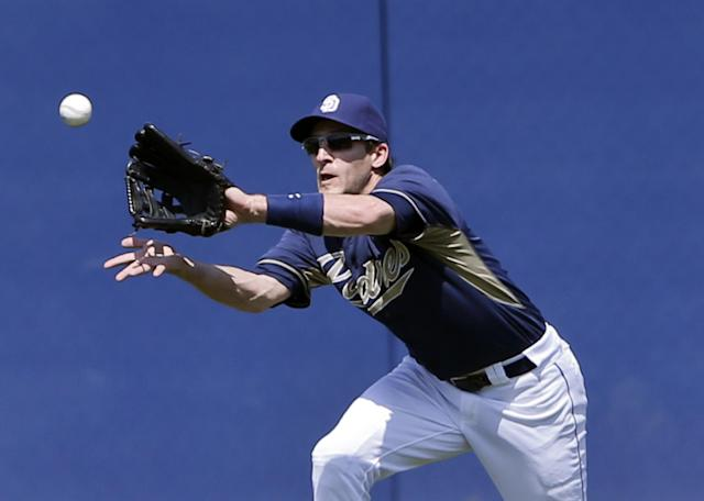 San Diego Padres' Chris Denorfia makes a running catch to deny a hit to Cleveland Indians' Lonnie Chisenhall in the third inning of a spring training exhibition baseball game, Saturday, March 29, 2014, in San Diego. (AP Photo/Lenny Ignelzi)