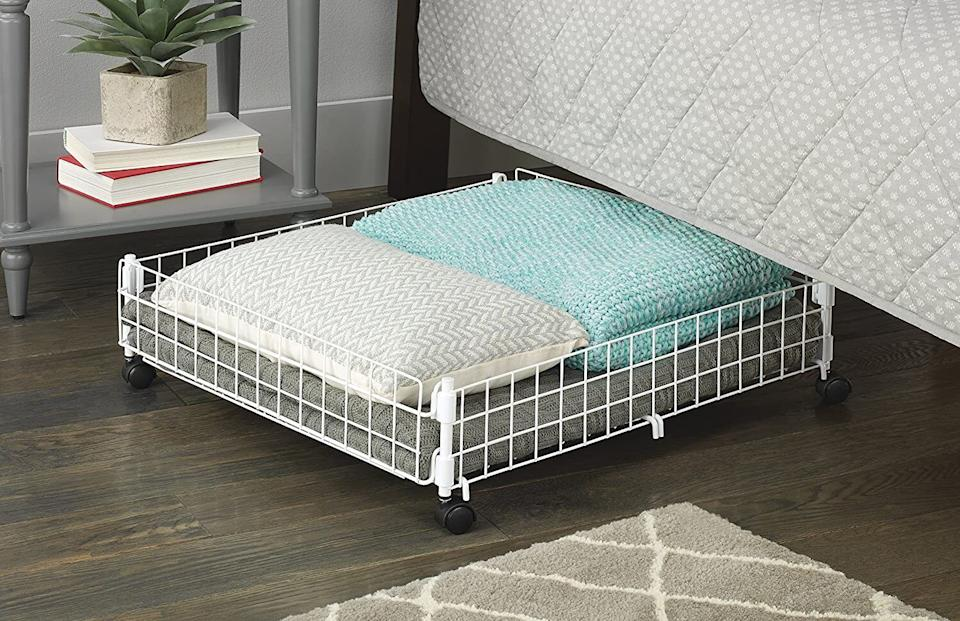 """It'll help youmaximize storage space and conceal all the bits and bobs that need hiding. You could probably even use it under your couch depending on how much space there is between the base and the floor.<br /><br /><strong>Promising review:</strong>""""Easy to build after you figure out which way the hooks go. Pay attention to the direction of the hooks on the picture; then it'll be easy and quick to assemble.<strong>I use it on carpet under my bed and my shoes are more organized.</strong>I like this way better than the cloth material shoe rack."""" --<a href=""""https://amzn.to/3emjcW2"""" target=""""_blank"""" rel=""""noopener noreferrer"""">Amazon Customer</a><br /><br /><strong>Get it from Amazon for <a href=""""https://amzn.to/3vKx2HI"""" target=""""_blank"""" rel=""""noopener noreferrer"""">$21.65</a>.</strong>"""