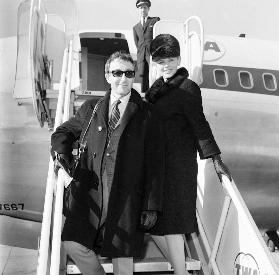 <p>Just before the holiday season began, Peter Sellers arrived in New York with his wife, Britt Ekland, to film <em>A Carol for Another Christmas. </em>The actor looked cool as he disembarked the aircraft in a black overcoat and sunglasses. </p>