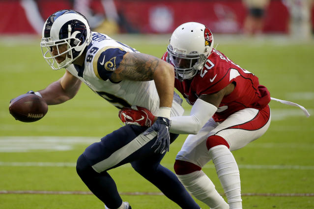 Arizona Cardinals defensive back Tramaine Brock (20) tackles Los Angeles Rams tight end Tyler Higbee (89) during the first half of an NFL football game, Sunday, Dec. 1, 2019, in Glendale, Ariz. (AP Photo/Rick Scuteri)