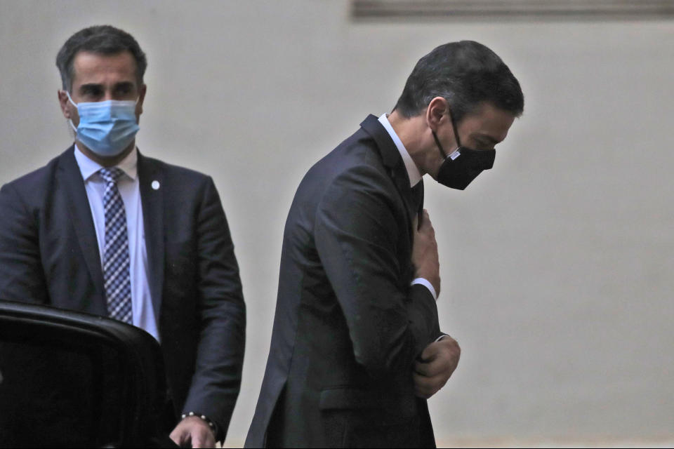 Spain's Prime Minister Pedro Sanchez, right, arrives at the San Damaso courtyard to meet Pope Francis, at the Vatican, Saturday, Oct. 24, 2020. (AP Photo/Alessandra Tarantino)