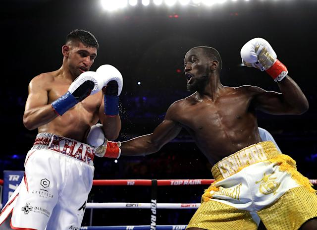 Terence Crawford punches Amir Khan during their WBO welterweight title fight at Madison Square Garden on April 20, 2019 in New York City. (Al Bello/Getty Images)
