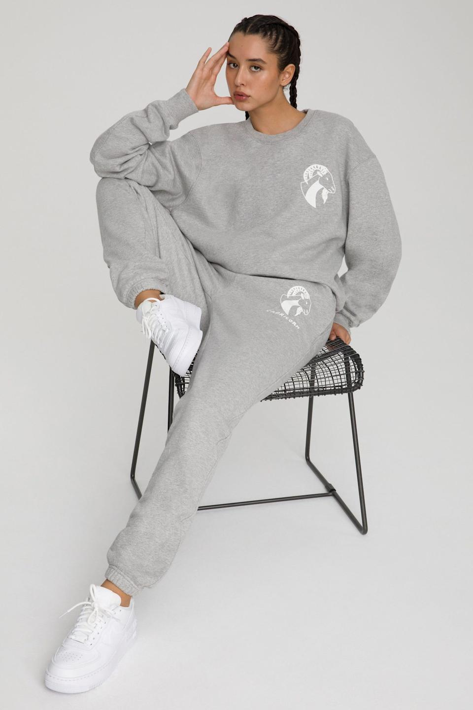 The Capricorn Zodiac Sweat Set from Good American. Sweatshirt, $124 and sweatpants, $105.