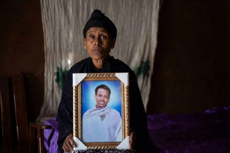 Mourning: Likitu Merdasa holds a portrait of her son, Desta Garuma