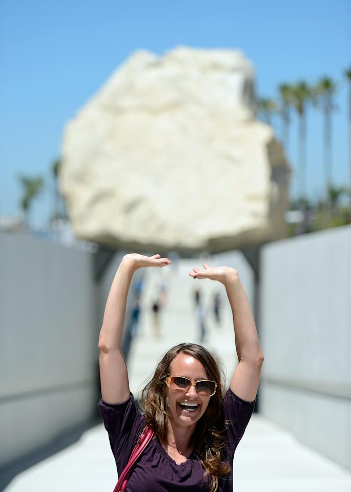 LOS ANGELES, CA - JUNE 26:  Michelle Frier poses with the new art exhibit  ''Levitated Mass,'' a permanent exhibit at the Los Angeles County Museum of Art in California on June 26, 2012 in Los Angeles, California. The exhibit was created by artist Michael Heizer, which features a 340-ton megalith rock.  (Photo by Kevork Djansezian/Getty Images)
