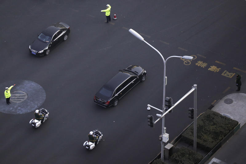 Traffic policemen direct traffic as a Mercedes limousine with a golden emblem, similar to one North Korean leader Kim Jong Un has used previously, is escorted by motorcades traveling past Chang'an Avenue in Beijing, Wednesday, Jan. 9, 2019. North Korean state media reported Tuesday that Kim is making a four-day trip to China in what's likely an effort by him to coordinate with his only major ally ahead of a summit with U.S. President Donald Trump that could happen early this year. (AP Photo/Andy Wong)