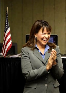 Christine O'Donnell listens to a Sept. 7 Tea Party Express event.