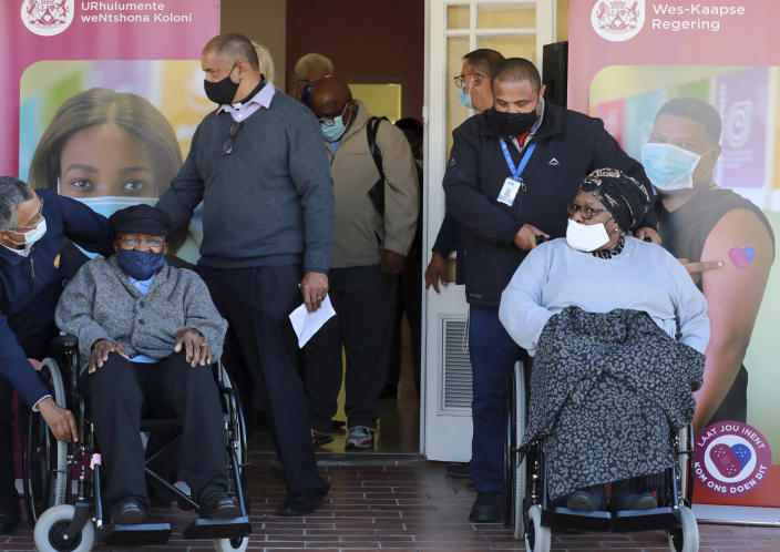 Anglican Archbishop Emeritus, Desmond Tutu left and his wife Leah leave, after receiving shots of the COVID-19 vaccine, at the Brooklyn Chest Hospital in Cape Town, South Africa, Monday, May 17, 2021. South Africa has started its mass vaccination drive with the goal of inoculating nearly 5 million citizens aged 60 and above by the end of June. (AP Photo/Nardus Engelbrecht)