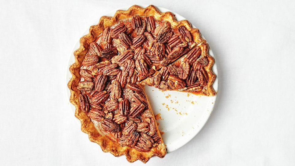 """If it's a bit too much to bake two pies this year, consider this mashup, a whiskey-spiked pumpkin pie with the most delicious candied pecan topping. <a href=""""https://www.epicurious.com/recipes/food/views/pecan-rye-pumpkin-pie?mbid=synd_yahoo_rss"""" rel=""""nofollow noopener"""" target=""""_blank"""" data-ylk=""""slk:See recipe."""" class=""""link rapid-noclick-resp"""">See recipe.</a>"""