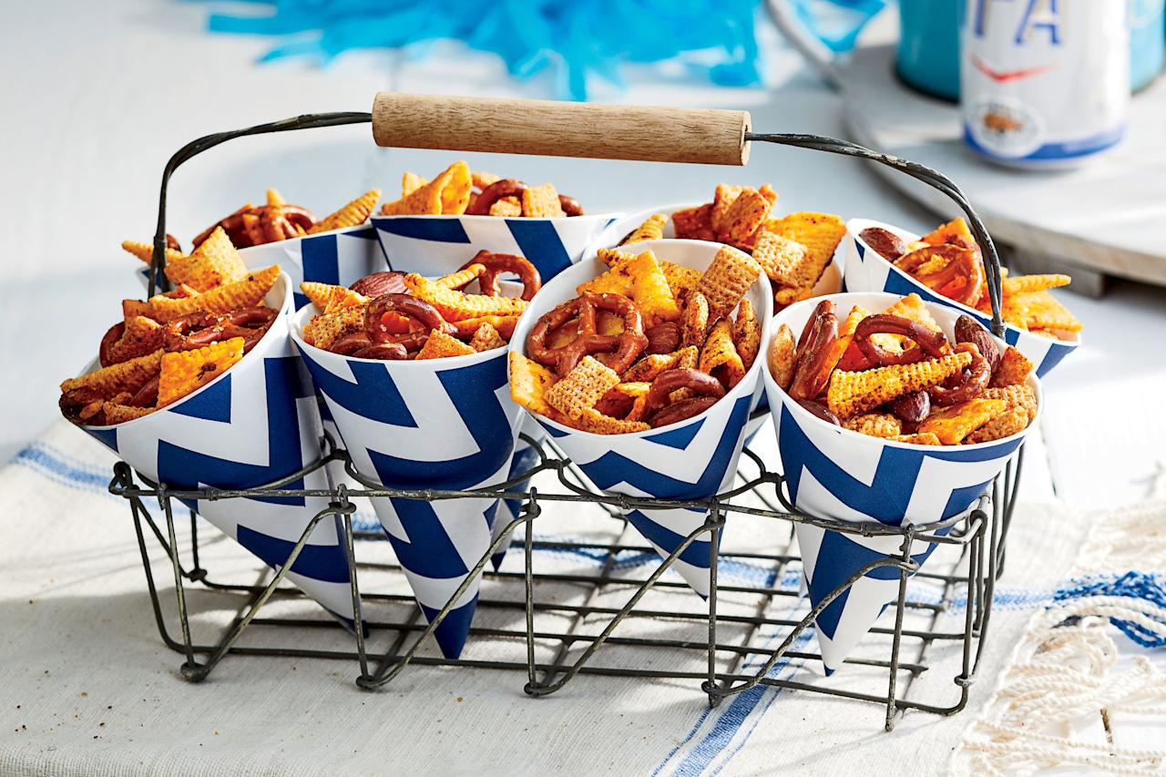 """<p><b>Recipe: </b><a href=""""https://www.southernliving.com/recipes/smoky-snack-mix-recipe""""><b>Smoky Snack Mix</b></a></p> <p>This snack mix incorporates lots of snacks you've got sitting around in your pantry, upgraded with sophisticated seasoning. A baggie of this snack mix will be a schoolyard favorite.</p>"""