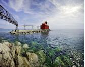 <p>The vivid red Sturgeon Bay Lighthouse really stands out on the blue water in Door County, Wisconsin.</p>