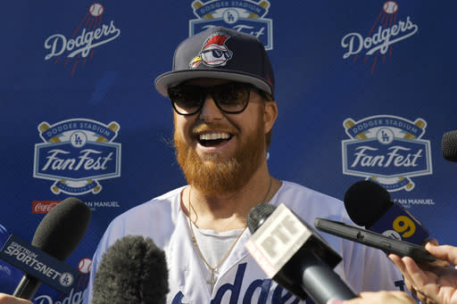 Los Angeles Dodgers' Justin Turner is interviewed by reporters during Dodger Stadium FanFest Saturday, Jan. 25, 2020, in Los Angeles. (AP Photo/Mark J. Terrill)