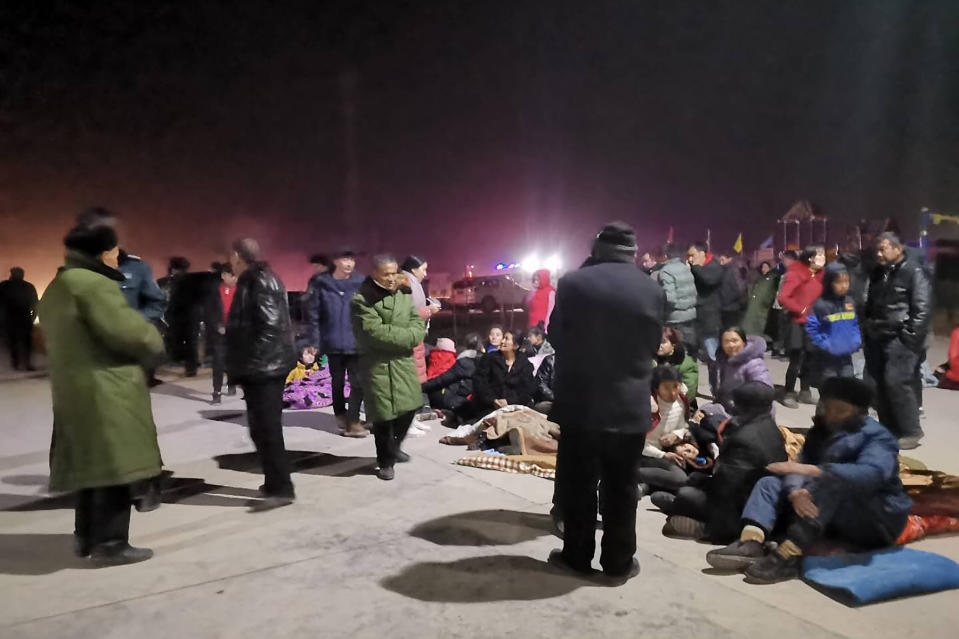 In this photo released by China's Xinhua News Agency, people gather in an open area after an earthquake in Jiashi County of Kashgar prefecture in northwestern China's Xinjiang Uighur Autonomous Region, Monday, Jan. 20, 2020. A strong earthquake has damaged buildings and injured at least one person seriously in China's far west Xinjiang region. (Li Chengxin/Xinhua via AP)