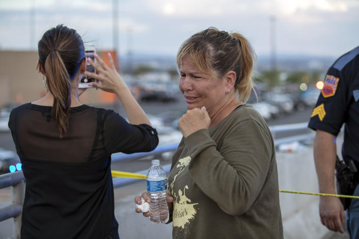 Edie Hallberg looks for her missing mother, Angie Englisbee, 87, who was in the Walmart store during the mass shooting in El Paso, Texas, Aug. 3, 2019. (Photo: Andres Leighton/AP)