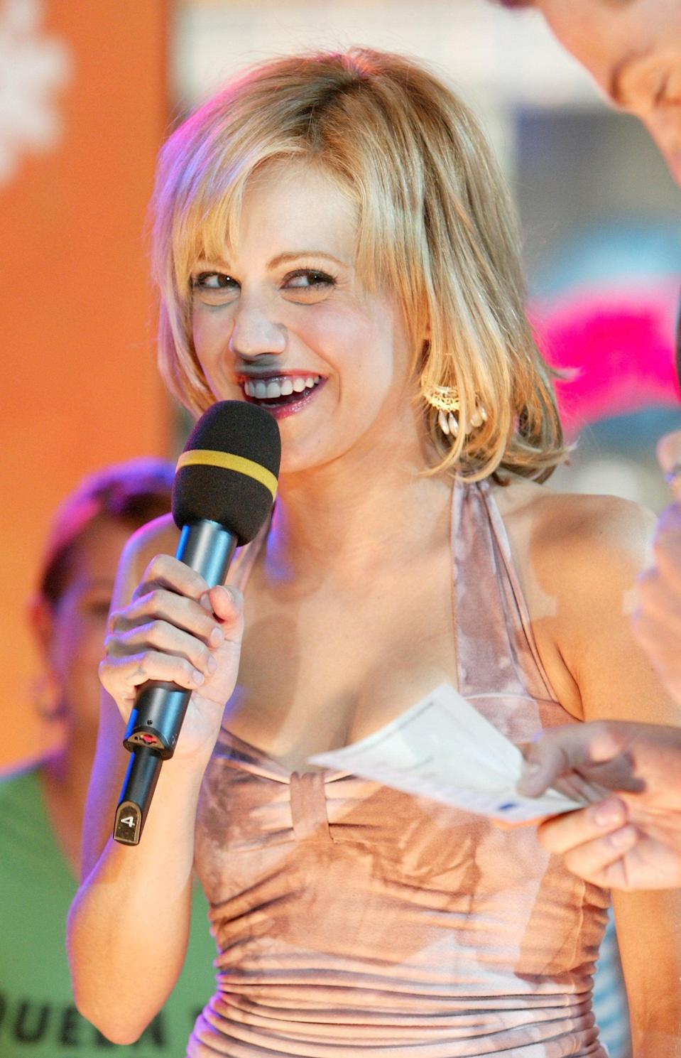 """<p><a class=""""link rapid-noclick-resp"""" href=""""https://www.popsugar.com/Brittany-Murphy"""" rel=""""nofollow noopener"""" target=""""_blank"""" data-ylk=""""slk:Brittany Murphy"""">Brittany Murphy</a> promoted her movie <b>Uptown Girls</b> with a 2003 <b>TRL</b> appearance.</p>"""