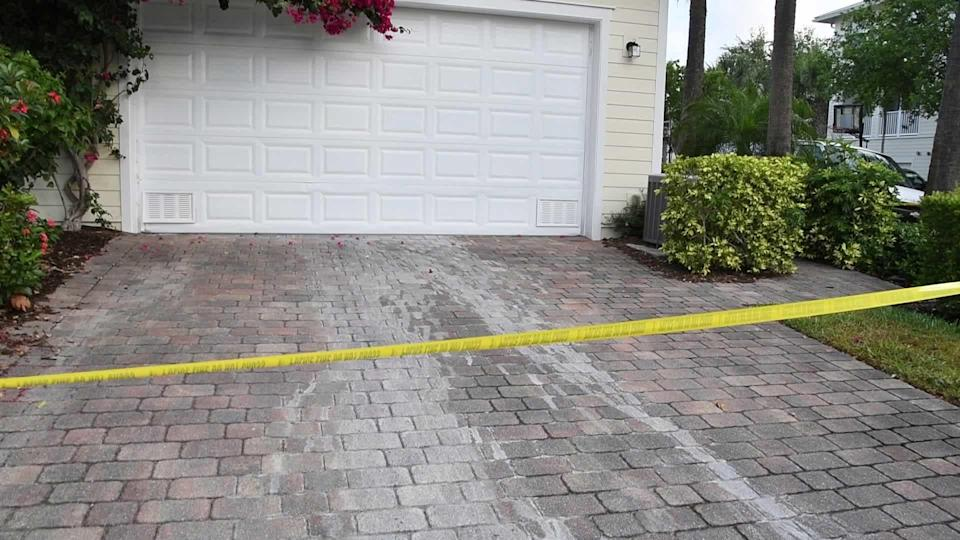 At Gretchen Anthony's home, investigators discovered a potential crime scene. Police say this image appears to show stains from a mysterious soapy substance on the driveway. / Credit: Palm Beach County State Attorney's Office