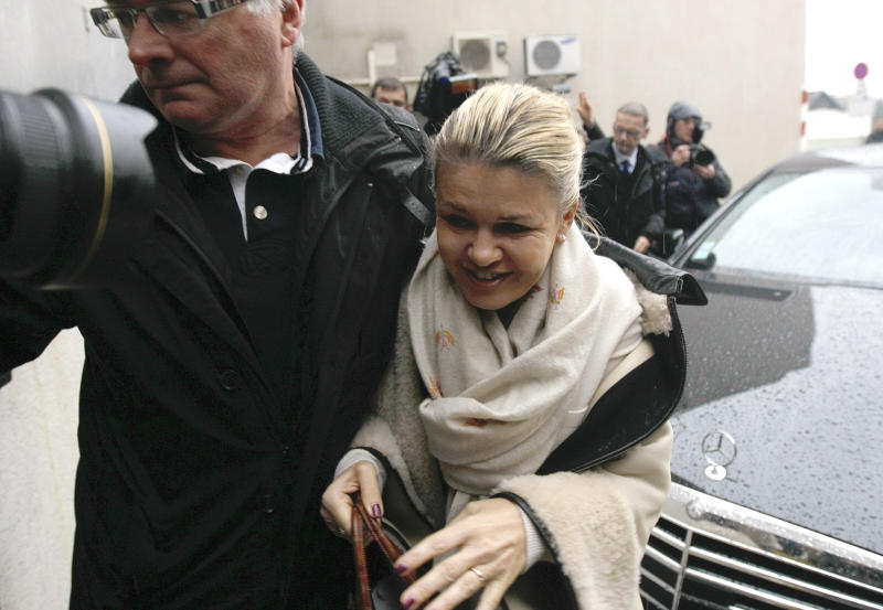 Michael Schumacher's wife, Corinna arrives at the Grenoble hospital, French Alps, Saturday, Jan. 4, 2014, where former seven-time Formula One champion Michael Schumacher is being treated after sustaining a head injury during a ski accident. Schumacher has been in a medically induced coma since Sunday, when he struck his head on a rock while on a family vacation. (AP Photo/Claude Paris)