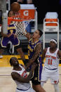 Los Angeles Lakers forward Kyle Kuzma (0) shoots against New York Knicks forward Julius Randle (30) during the second quarter of a basketball game Tuesday, May 11, 2021, in Los Angeles. (AP Photo/Ashley Landis)