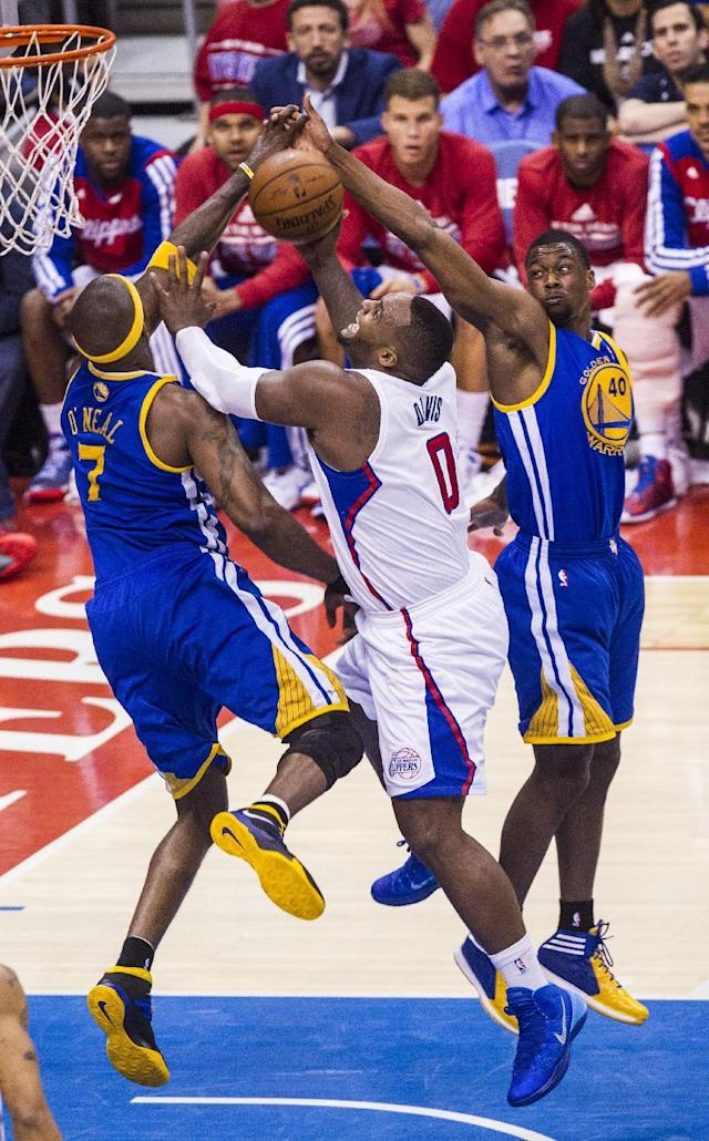 Los Angeles Clippers forward Glen Davis (0) goes up for a lay up against Golden State Warriors forwards Jermaine O'Neal (7), and Harrison Barnes (40) during the first halff of Game 7 of a first-round NBA basketball playoff series, Saturday, May 3, 2014, in Los Angeles. (AP Photo/Ringo H.W. Chiu)