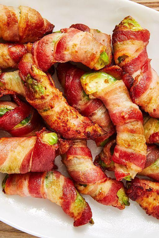 """<p>You can't say no to anything wrapped in bacon. These low-carb """"fries"""" turn a regular slice of <a href=""""https://www.delish.com/uk/cooking/recipes/a31952820/prawn-salad/"""" rel=""""nofollow noopener"""" target=""""_blank"""" data-ylk=""""slk:avocado"""" class=""""link rapid-noclick-resp"""">avocado</a> into something extraordinary. We've included an oven-baked version as well as an air fryer version down below. </p><p>Get the <a href=""""https://www.delish.com/uk/cooking/recipes/a32027689/bacon-avocado-fries-recipe/"""" rel=""""nofollow noopener"""" target=""""_blank"""" data-ylk=""""slk:Bacon Avocado Fries"""" class=""""link rapid-noclick-resp"""">Bacon Avocado Fries</a> recipe.</p>"""