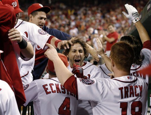 Washington Nationals' Michael Morse, center, celebrates his grand slam during the fourth inning of a baseball game against the New York Mets at Nationals Park on Friday, Aug. 17, 2012, in Washington. The Nationals won 6-4. (AP Photo/Alex Brandon)