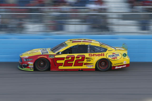 Joey Logano drives into Turn 4 during a NASCAR Cup Series auto race at ISM Raceway, Sunday, Nov. 10, 2019, in Avondale, Ariz. (AP Photo/Ralph Freso)